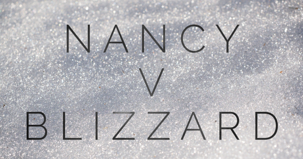 "Snow with the words ""Nancy v Blizzard"""